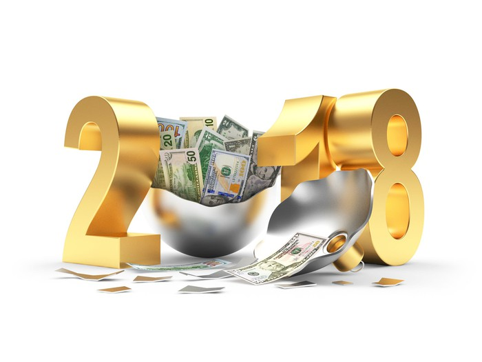 2018 with zero formed by opened silver bell full of cash
