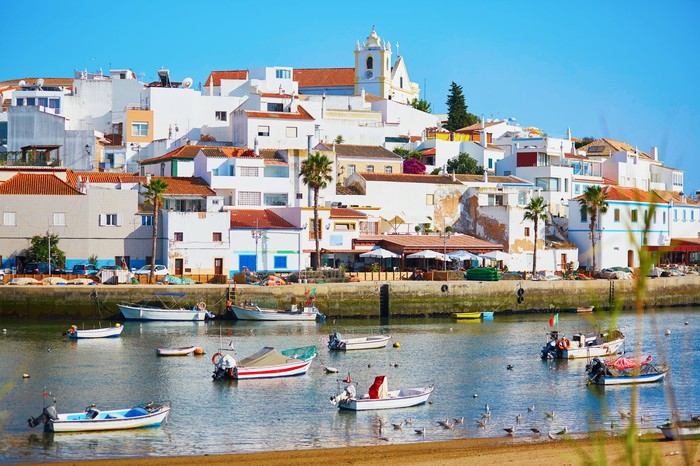 Scenic view of fishing boats in Ferragudo, Algarve, Portugal