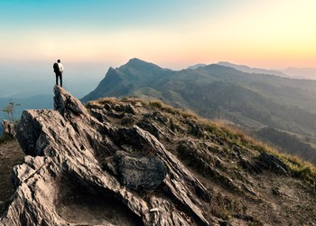 man on cliff GettyImages-512151814