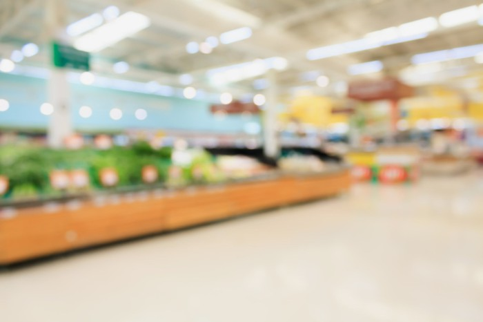 A blurry picture of the interior of a grocery store