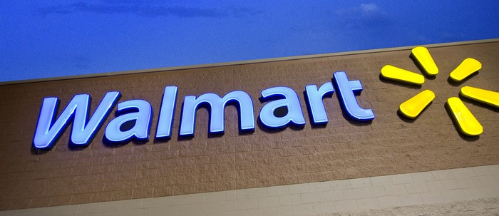 A Wal-Mart sign on a storefront.