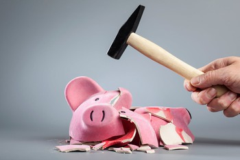 Getty Piggy Bank Broken with Hammer