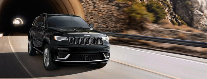 A 2018 Jeep Grand Cherokee driving out of a tunnel.