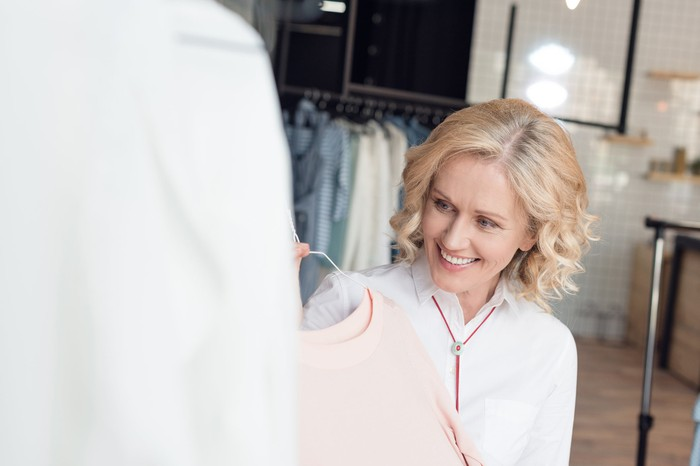 Woman choosing clothes in a clothing store