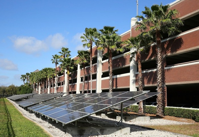 A solar-panel installation next to a parking structure