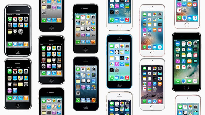 Many Apple iPhones, lying flat.