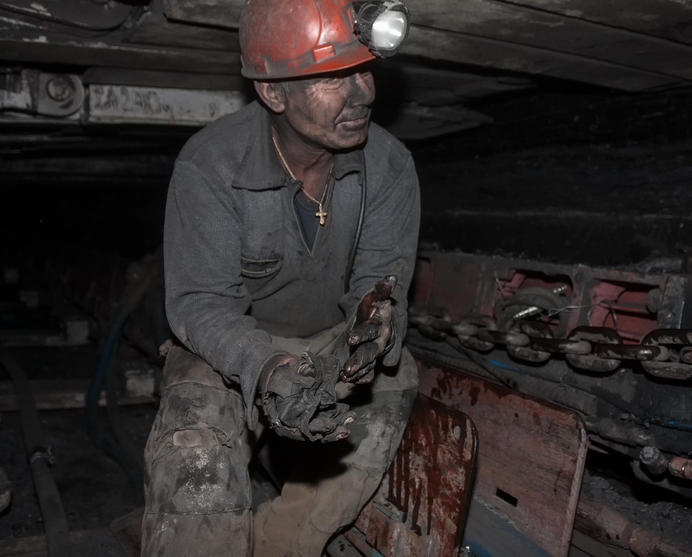 A coal miner working in a mine
