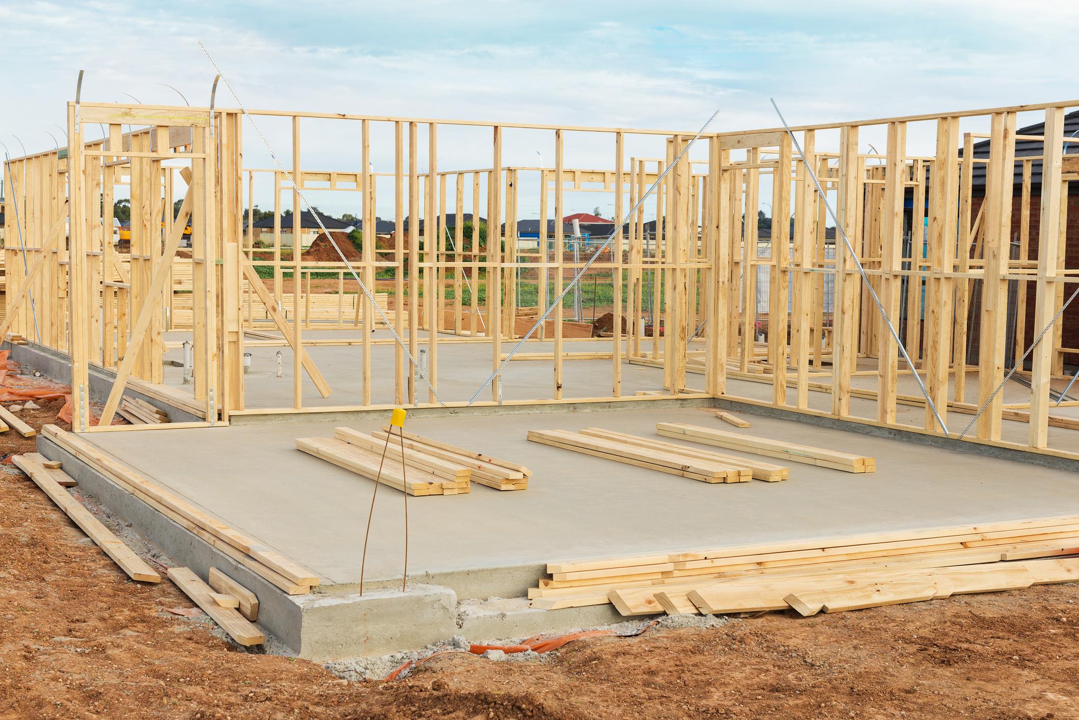 Home frame atop concrete foundation