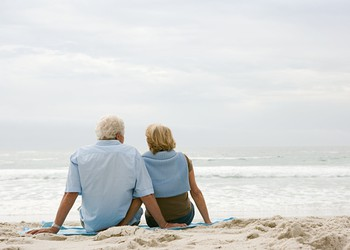retired couple on beach_GettyImages-71035684