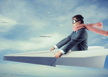 Getty Paper Plane With Man in Suit Riding