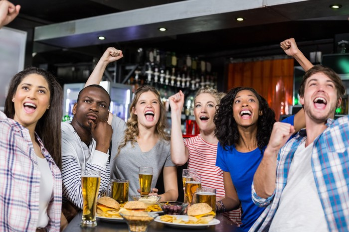 Friends watching sports at a sports bar.