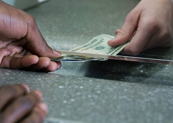 Cash at bank window by Getty