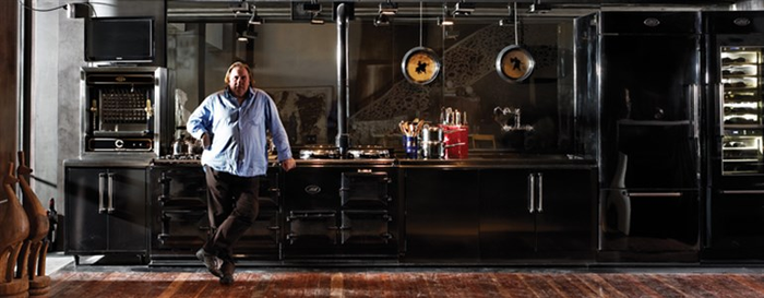 Acclaimed actor Gerard Depardieu standing in front of an AGA cooker.