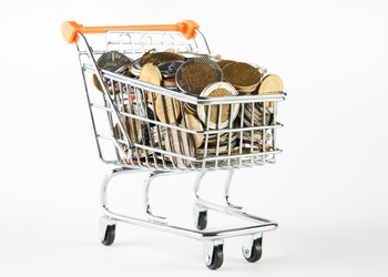 shopping cart filled with coins dollar store discounter deep getty