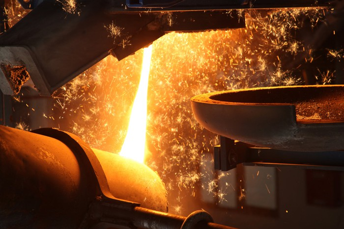 Molten metal being poured in a foundry.