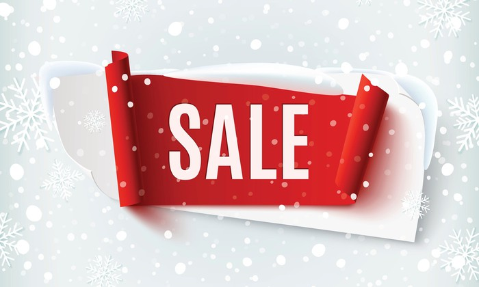 The word Sale in the center of the image, surrounded by snowflakes.