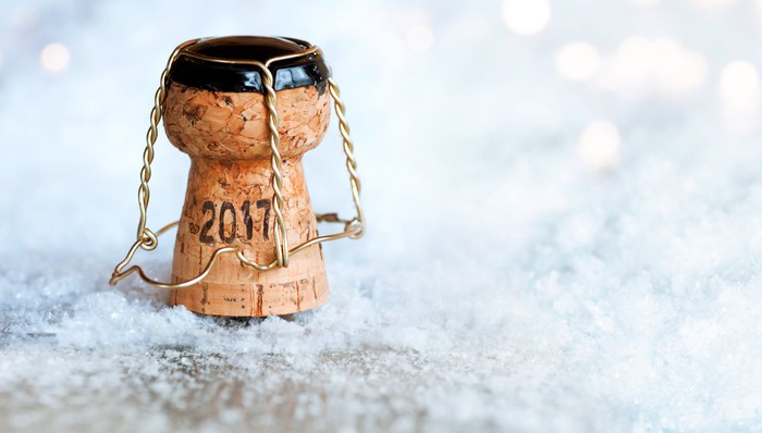 Champagne cork with 2017 written on it.