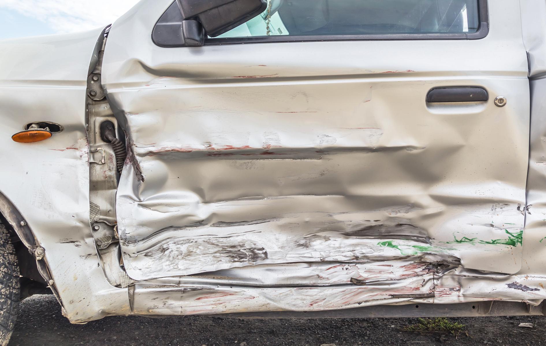 A dented car door.