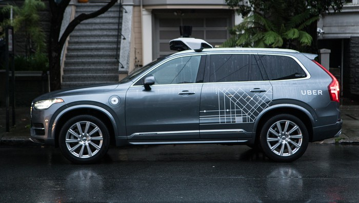 A grey Volvo SUV with Uber logo on it.