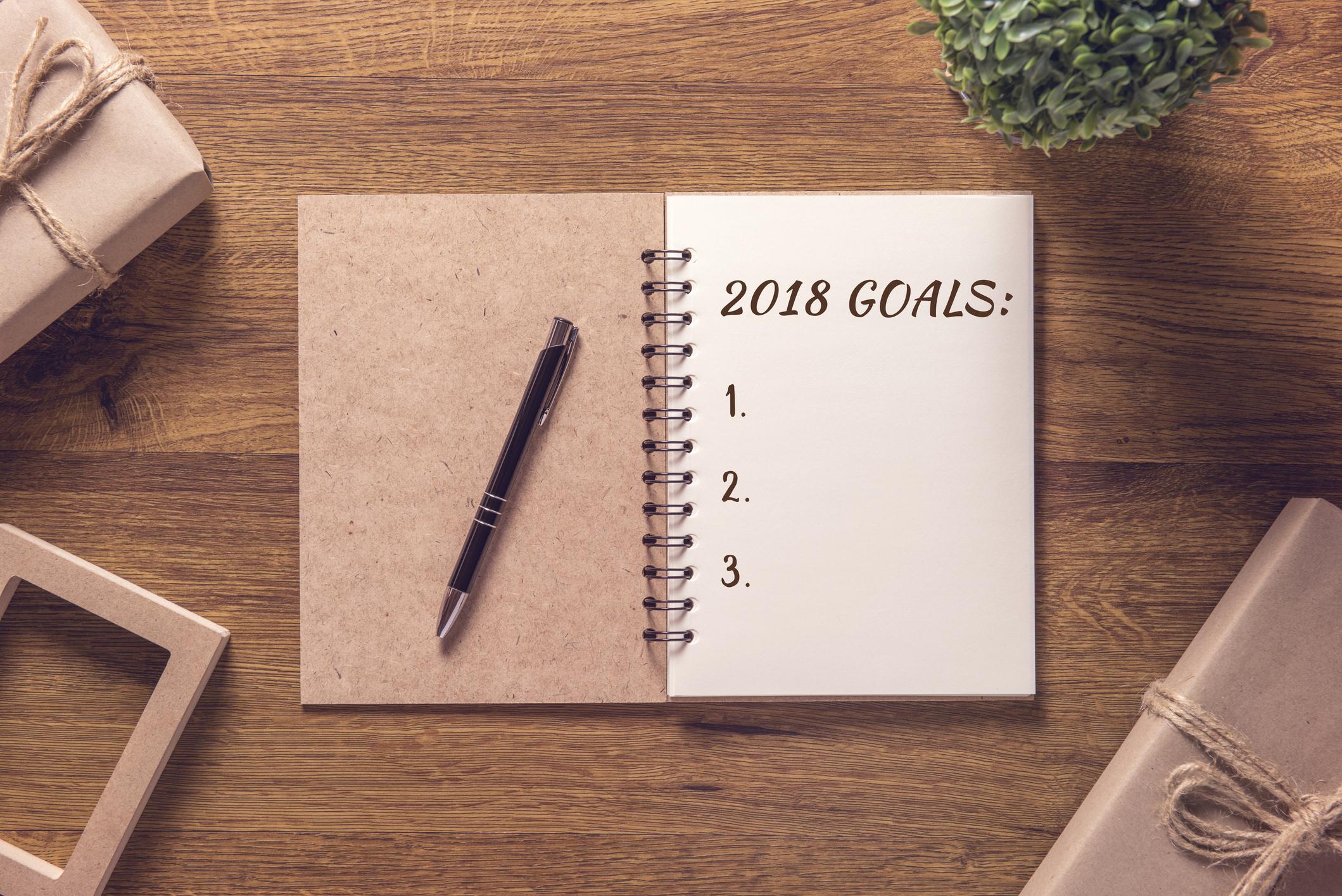 Notebook with 2018 goals written on a sheet of paper