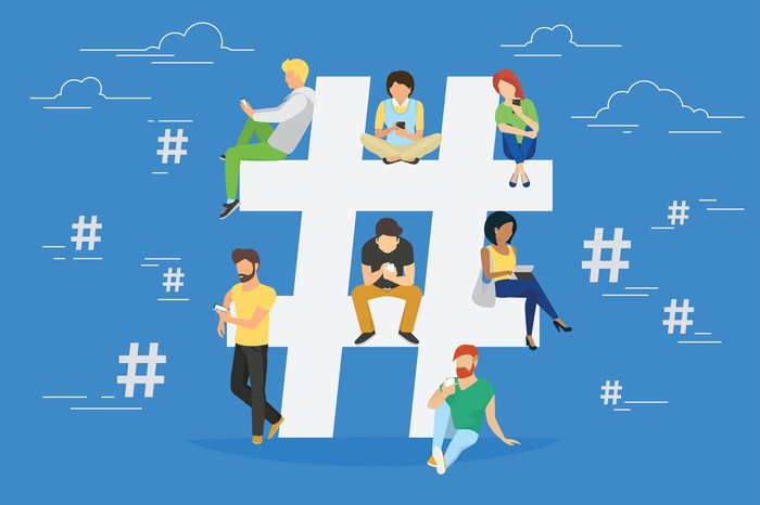 Illustration of users sitting on and hanging around a hashtag