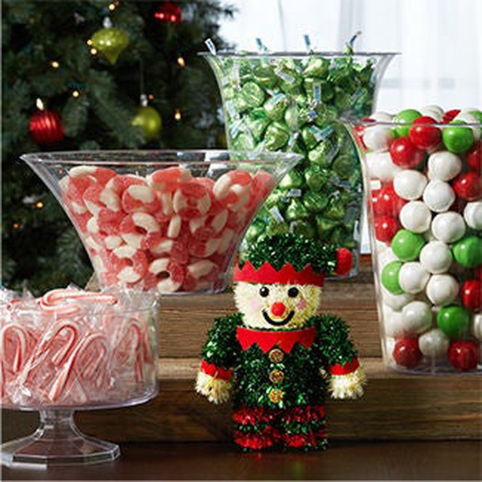 A collection of Christmas-themed candy and decorations.