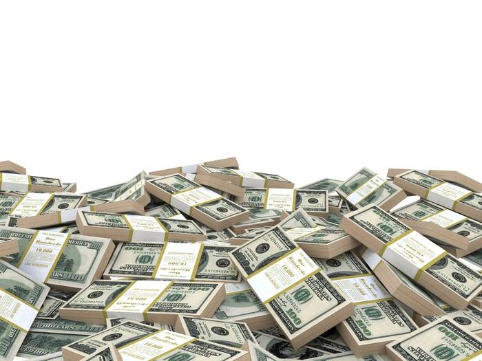 Straps of U.S. hundred-dollar bills in a pile.