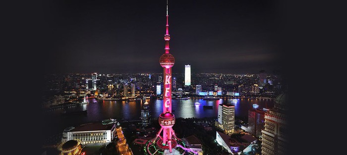 Shanghai skyline celebrating the year year anniversary of KFC in China by putting the brand's logo on its Pearl Tower.