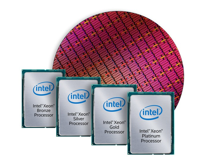 A wafer of Intel chips in the background with fully packaged chips in the foreground.