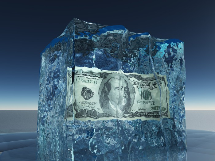 A $100 bill encased in a block of ice