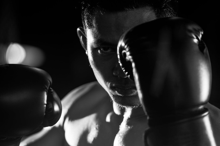 A boxer with his gloves up