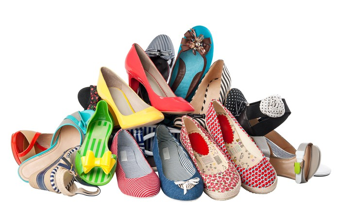A pile of female summer shoes.