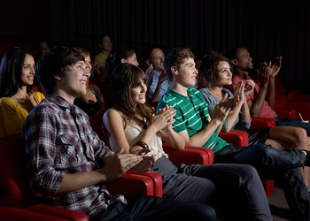 Clapping crowd in movie theater