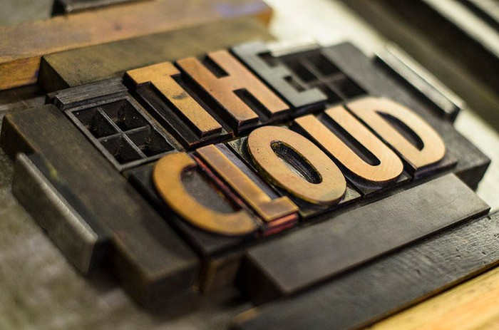 Close up picture of a printer's letters spelling out The Cloud.