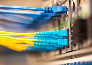 Fiber optic cables plugged into router
