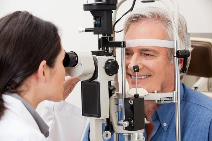 Senior male getting an eye exam
