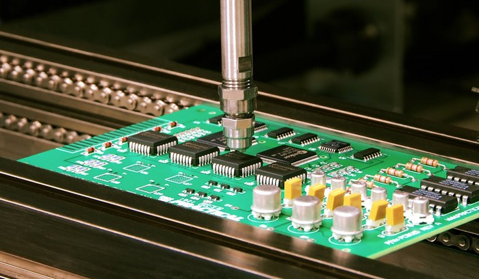 Circuit board with machinery applying adhesive