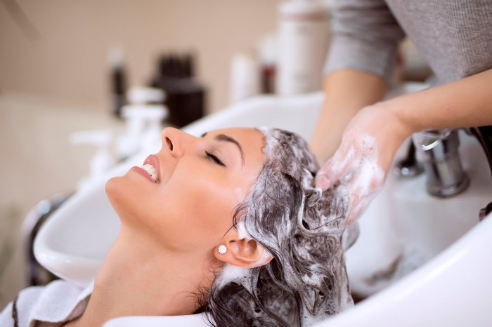 Woman getting her hair washed in salon