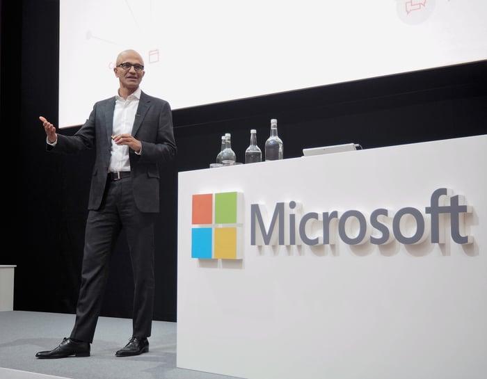 Microsoft CEO Satya Nadella on a stage giving a talk.