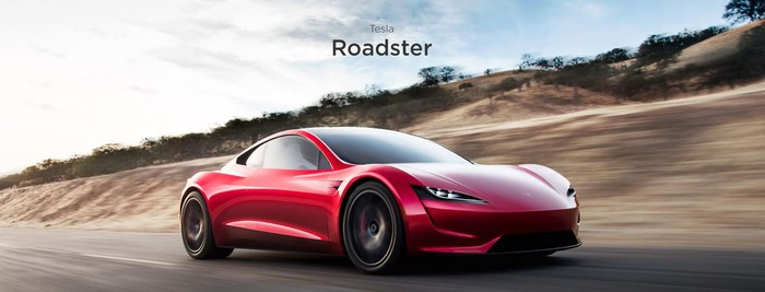 A red Tesla Roadster sports car