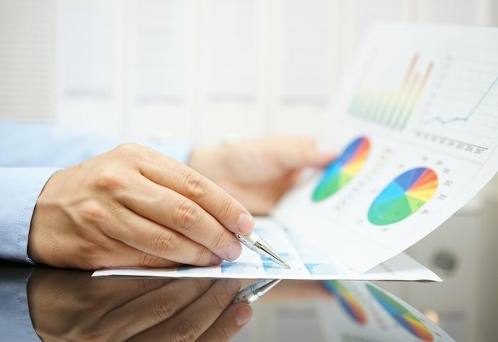 An investor looks at financial charts.
