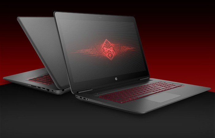 Picture of two HP OMEN laptops open on a table back to back.