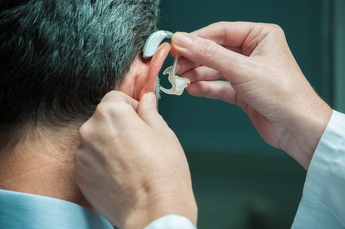 Man getting fitted for hearing aid
