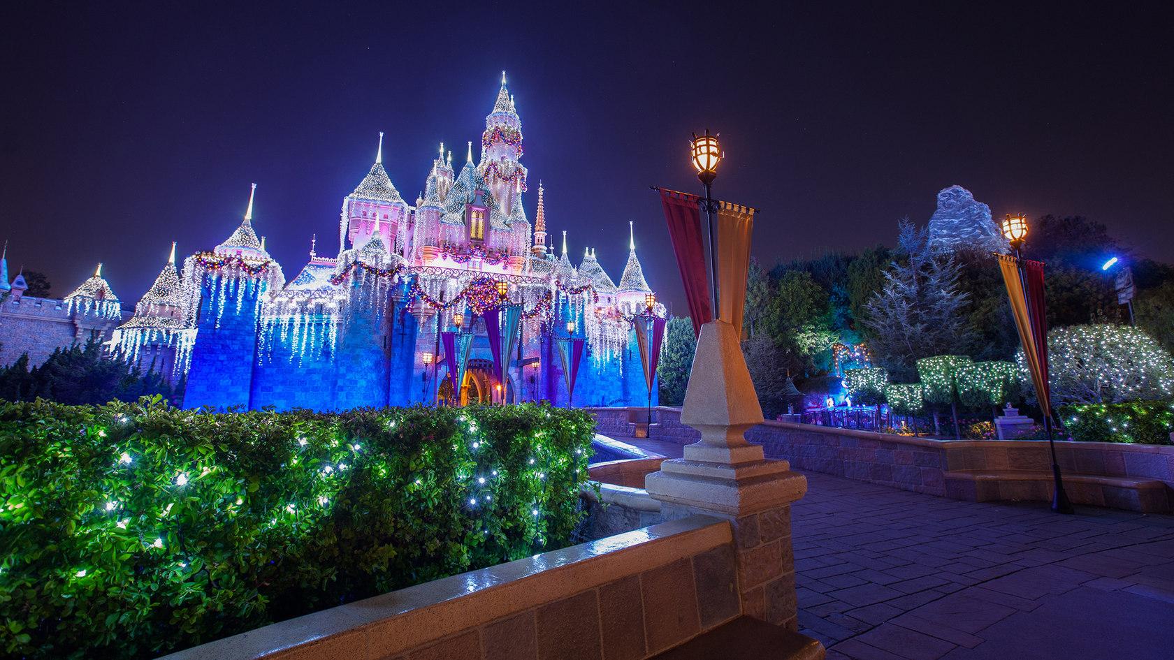 Disney's Sleeping Beauty Castle lit up at nighttime.