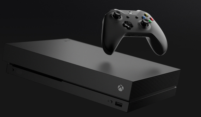 A black Xbox One X is shown floating in the air with a solid black background.