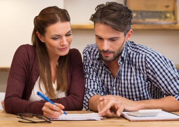 couple managing finances_GettyImages-505472368
