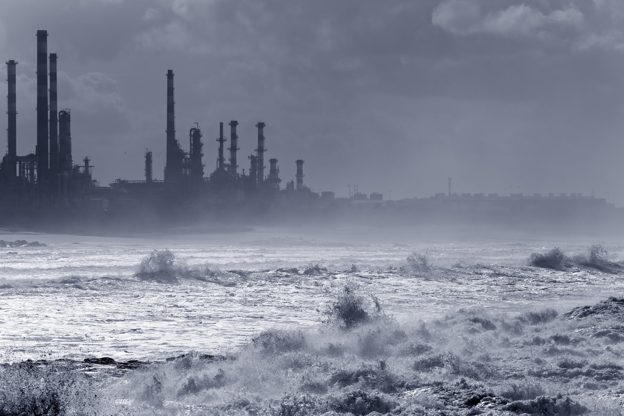 A storm hitting an energy facility along the coast.