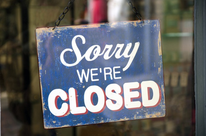 "A sign reading ""sorry we're closed."""