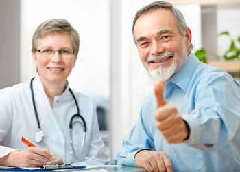 patient-giving-thumbs-up-with-doctor-getty
