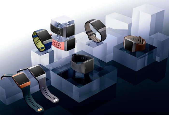 Fitbit smartwatches sitting on blocks.